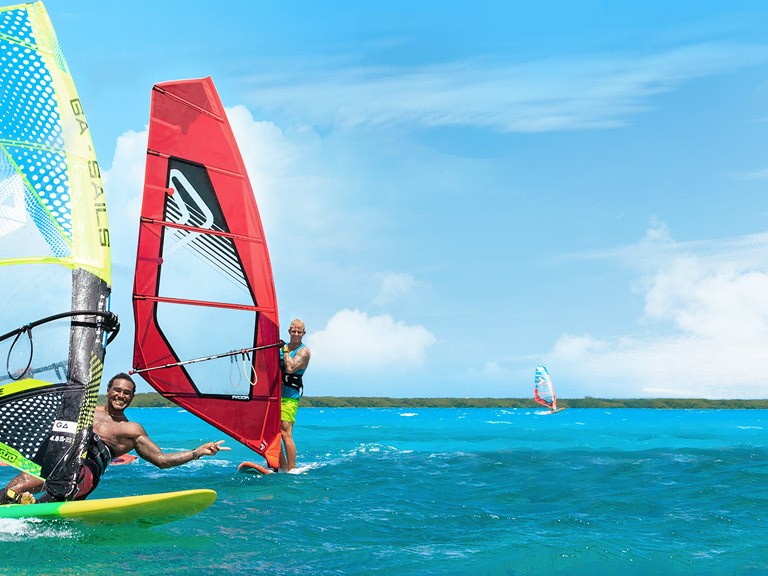 two men windsurfing